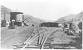 South facing view from the 3-way switch at the north end of the RGS Rico yards, showing the water tank, depot, and engine house.<br /> RGS  Rico, CO  Taken by Jackson, Richard B. - 7/7/1939