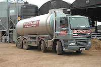 Milk tanker in a farm yard, picking up milk for Belton Cheese.