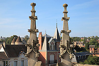 Pinnacles and Rooftop view of the city from the roof of the Collegiale Notre-Dame de Poissy, showing the Western bell tower and chapels of the North aisle, a catholic parish church founded c. 1016 by Robert the Pious and rebuilt 1130-60 in late Romanesque and early Gothic styles, in Poissy, Yvelines, France. Saint Louis was baptised here in 1214. The Collegiate Church of Our Lady of Poissy was listed as a Historic Monument in 1840 and has been restored by Eugene Viollet-le-Duc. Picture by Manuel Cohen