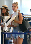 Anna Heinrich Gives Death Stare To Pap At Puglia Airport