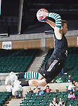 Spring board high jumpers dunking the basketball at the halftime show during the game between the Louisiana Monroe Warhawks and the University of North Texas Mean Green at the North Texas Coliseum,the Super Pit, in Denton, Texas. UNT defeats ULM 86 to 51....
