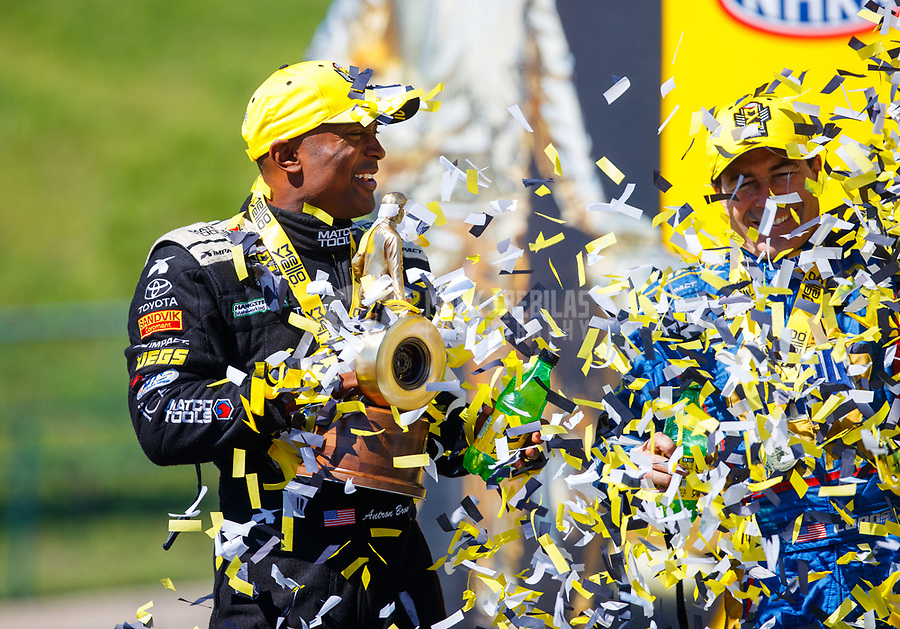 May 21, 2017; Topeka, KS, USA; Confetti falls as NHRA top fuel driver Antron Brown celebrates after winning the Heartland Nationals at Heartland Park Topeka. Mandatory Credit: Mark J. Rebilas-USA TODAY Sports