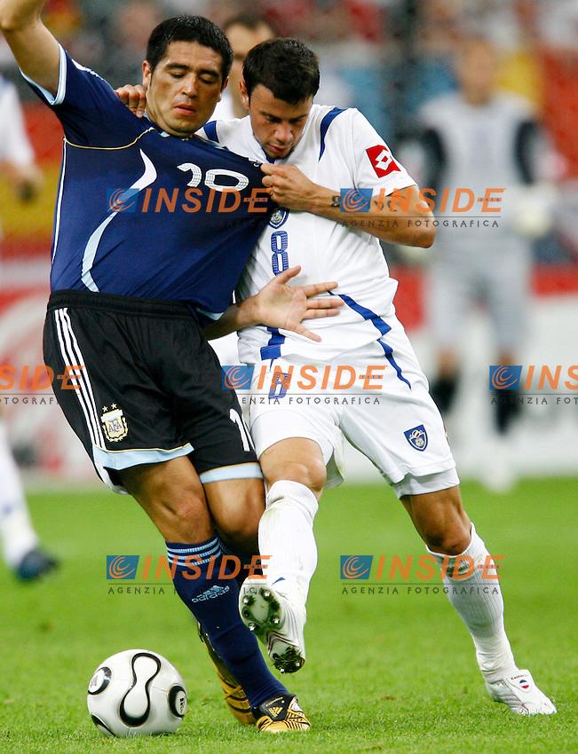 Gelsenkirchen 16/6/2006 World Cup 2006.Argentina Serbia & Montenegro 6-0.Photo Andrea Staccioli Insidefoto.Juan Riquelme Argentina and Mateja Ketzman Serbia