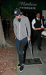 AbilityFilms@yahoo.com.805-427-3519.www.AbilityFilms.com.....4-9-09.Lukas Haas leaving Madeos restaurant on crutches in Leonardo Dicaprio car in Beverly hills ca