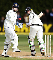 Martin Guptill watches as the ball gets past Indian keeper MS Dhoni (left) during day four of the 3rd test between the New Zealand Black Caps and India at Allied Prime Basin Reserve, Wellington, New Zealand on Monday, 6 April 2009. Photo: Dave Lintott / lintottphoto.co.nz.
