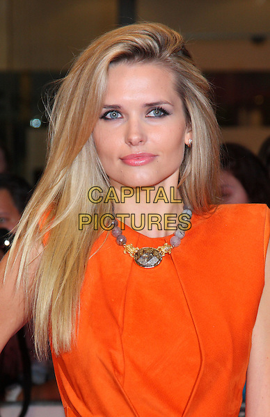 "Agne Motiejunaite.""One Day"" UK premiere, Vue Westfield cinema, Westfield Shopping Centre, London, England..August 23rd, 2011.half length dress sleeveless orange dress necklace headshot portrait .CAP/ROS.©Steve Ross/Capital Pictures"