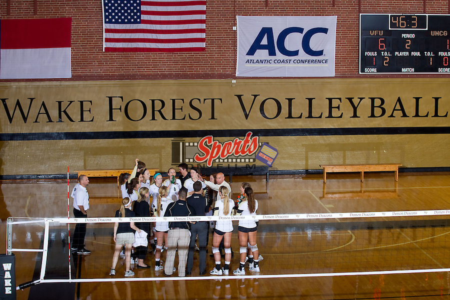 The Wake Forest Demon Deacons huddle up during a time out in the second set against the UNC Greensboro Spartans in Reynolds Gymnasium on August 31, 2013 in Wake Forest, North Carolina.  The Demon Deacons defeated the Spartans 3-0.   (Brian Westerholt/Sports On Film)