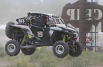 Mike Guenther flies past the flag stand during the Buffalo Chip 100 off-road racing event Saturday at the T.O.R.C. track in Sturgis, S.D.  (Photo by Richard Carlson/Inertia)