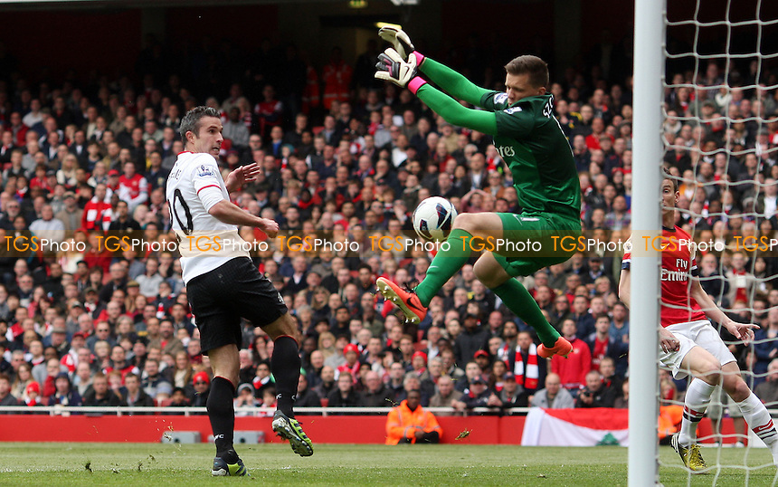 Robin Van Persie of Manchester United sees his close range header saved by the face of Arsenal keeper Wojciech Szczesny - Arsenal vs Manchester United, Barclays Premier League at the Emirates, Arsenal - 28/04/13 - MANDATORY CREDIT: Rob Newell/TGSPHOTO - Self billing applies where appropriate - 0845 094 6026 - contact@tgsphoto.co.uk - NO UNPAID USE.