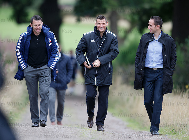 Dougie Freedman, Lee McCulloch and John Kennedy walking to the pitch to take in Scotland's training techniques