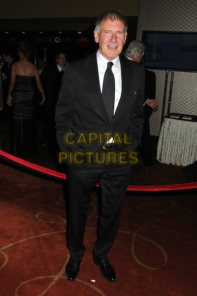 Harrison Ford.50th Anniversary Stuntmens Gala Honoring Harrison Ford held at the Universal Hilton Hotel, Universal City, California, USA. .September 24th, 2011.full length suit hands in pockets white tie black  .CAP/ADM/BP.©Byron Purvis/AdMedia/Capital Pictures.