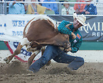 Timmy Sparing competes in the Steer Wrestling event during the Reno Rodeo in Reno, Nevada on Saturday, June 23, 2018.