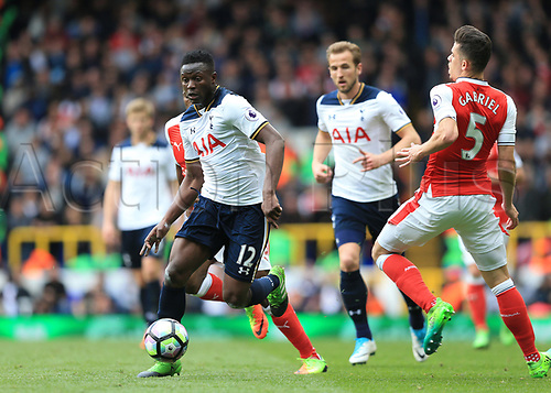 April 30th 2017, White Hart Lane, Tottenham, London England; EPL Premier League football Tottenham Hotspur versus Arsenal; Victor Wanyama of Tottenham Hotspur runs passed Gabriel Paulista of Arsenal