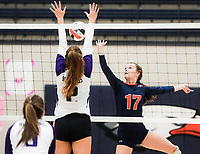 NWA Democrat-Gazette/CHARLIE KAIJO Rogers Heritage High School Kayley McClain (17) blocks during a volleyball game, Thursday, October 11, 2018 at Rogers Heritage High School in Rogers.