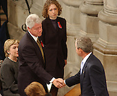 United States President George W. Bush shakes hands with former U.S. President Bill Clinton as he arrives at the Washington National Cathedral in Washington, D.C. on Friday, September 14, 2001 for a prayer service. Chelsea Clinton and her mother, U.S. Senator Hillary Rodham Clinton (Democrat of New York) look on..Credit: Ron Sachs / CNP