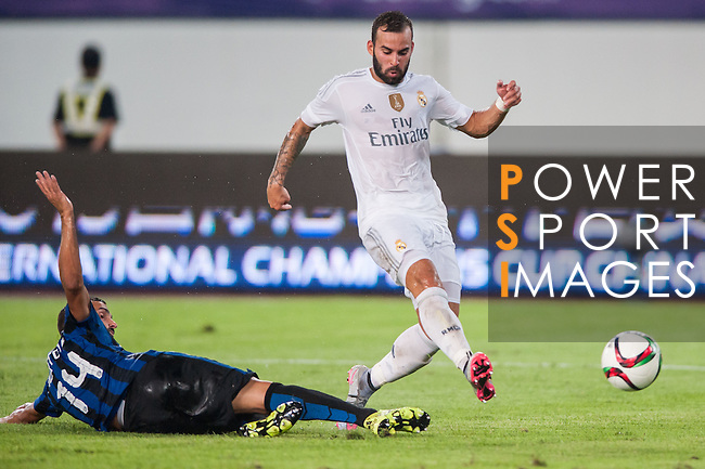 (R) Jese Rodriguez of Real Madrid CF being followed by (L) Martin Motoya of FC Internazionale Milano during the FC Internazionale Milano vs Real Madrid  as part of the International Champions Cup 2015 at the Tianhe Sports Centre on 27 July 2015 in Guangzhou, China. Photo by Hendrik Frank / Power Sport Images