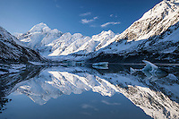 Icebergs & perfect mirror reflections of Aoraki Mt Cook, the Cook Range and the Southern Alps from Hooker Glacier Terminal Lake.  Aoraki Mt Cook National Park, South Canterbury New Zealand.