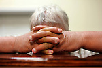 Prayer at the Gospel Light Baptist Church, in Hazard, Ky. Wednesday Oct. 9, 2013. Photo by Judah Taylor