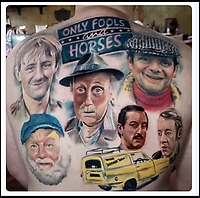 BNPS.co.uk (01202 558833)<br /> Pic:    DeanPaine/BNPS<br /> <br /> The finished article....<br /> <br /> Mon Dieu! An Only Fools and Horses superfan has been to 'Hull and Back' to pay tribute to the classic BBC sitcom.<br /> <br /> Dean Paine sat through 50 hours of agony to have the show's main characters tattooed on his back.<br /> <br /> Dean designed the brilliant body art himself using colour photos of Del Boy, Rodney, Grandad, Uncle Albert, Boycie and Trigger.<br /> <br /> He also included the Only Fools and Horses emblem and Del's famous yellow three wheeled van.