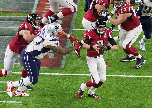 February 5th 2017, Houston, Texas, USA;   New England Patriots defensive end Alan Branch (97) reaches out to tackle Atlanta Falcons quarterback Matt Ryan (2) during the New England Patriots 34-28 victory over the Atlanta Falcons