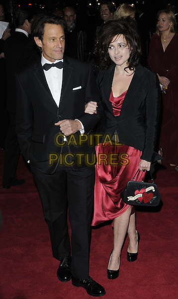 Michael Kaplan & Helena Bonham Carter.The 'Hollywood Costume' gala dinner, V&A Museum, London, England..October 16th, 2012.full length black tuxedo white shirt blazer red silk satin dress heart print handbag purse.CAP/CAN.©Can Nguyen/Capital Pictures.