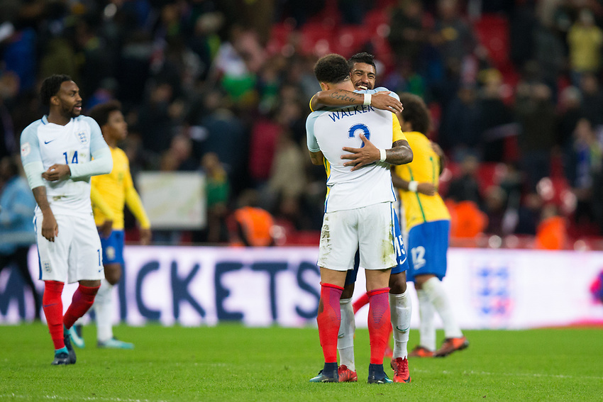 Brazil&rsquo;s Paulinho embraces England's Kyle Walker <br /> <br /> Photographer Craig Mercer/CameraSport<br /> <br /> The Bobby Moore Fund International - England v Brazil - Tuesday 14th November 2017 Wembley Stadium - London  <br /> <br /> World Copyright &copy; 2017 CameraSport. All rights reserved. 43 Linden Ave. Countesthorpe. Leicester. England. LE8 5PG - Tel: +44 (0) 116 277 4147 - admin@camerasport.com - www.camerasport.com