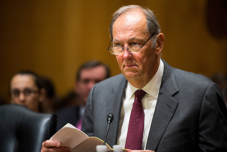 """UNITED STATES - FEBRUARY 10: Former Sen. Bill Bradley, D-N.J., takes his seat for the Senate Finance Committee hearing on """"Getting to Yes on Tax Reform: What Lessons Can Congress Learn from the Tax Reform Act of 1986?"""" on Tuesday, Feb. 10, 2015. (Photo By Bill Clark/CQ Roll Call)"""