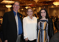 NWA Democrat-Gazette/CARIN SCHOPPMEYER Jack Eaton, SPSF Benton County executive director; Sara Chambers, scholarship recipient; and her daughter Diana Schoop gather for a photo at the Corporate Luncheon on April 18 at the Embassy Suites in Rogers.