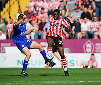 Lincoln City's John Akinde vies for possession with Tranmere Rovers' Evan Gumbs<br /> <br /> Photographer Chris Vaughan/CameraSport<br /> <br /> The EFL Sky Bet League Two - Lincoln City v Tranmere Rovers - Monday 22nd April 2019 - Sincil Bank - Lincoln<br /> <br /> World Copyright © 2019 CameraSport. All rights reserved. 43 Linden Ave. Countesthorpe. Leicester. England. LE8 5PG - Tel: +44 (0) 116 277 4147 - admin@camerasport.com - www.camerasport.com