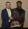 Kevon Hall of Roosevelt, 2018 Thorp Award recipient, poses for a portrait with head coach Joe Vito at the annual Nassau County Gridion Banquet at Crest Hollow Country Club in Woodbury on Wednesday, Dec. 5, 2018.