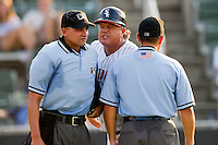 Kannapolis Intimidators manager Tommy Thompson #39 gives an earful to home plate umpire Jose Esteras as base umpire Roberto Ortiz looks on during the South Atlantic League game against the Delmarva Shorebirds at Fieldcrest Cannon Stadium on August 7, 2011 in Kannapolis, North Carolina.  The Intimidators defeated the Shorebirds 8-3.   (Brian Westerholt / Four Seam Images)