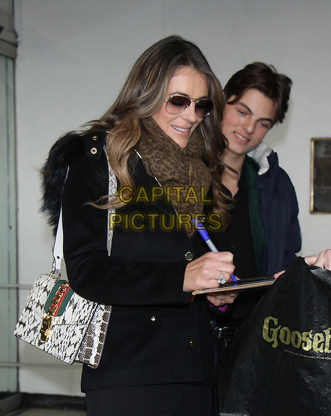 NEW YORK, NY - DECEMBER 1: Elizabeth Hurley and Damian Hurley at Harry promoting the new season of The Royals in New York City on December 01, 2016. <br /> CAP/MPI/RW<br /> &copy;RW/MPI/Capital Pictures