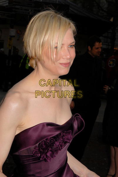 """RENEE ZELLWEGER .Attending the """"Leatherheads"""" European Film Premiere held at the Odeon cinema, Leicester Square London, England, 8th April 2008..portrait headshot strapless purple plum aubergine ruffle front .CAP/IA.©Ian Allis/Capital Pictures"""