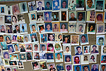 Photos laid out on the ground in Puerto Madero, Mexico, on December 17, 2013 by dozens of Central Americans looking for their loved ones who disappeared on the migrant trail north. The Central Americans, mostly mothers looking for their disappeared or trafficked children, came to Mexico for 17 days.