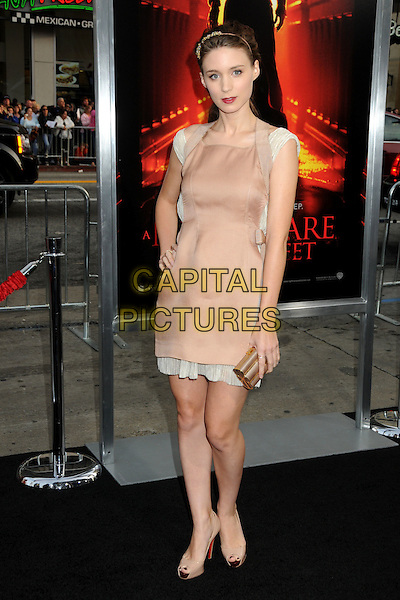 "ROONEY MARA .""A Nightmare On Elm Street"" Los Angeles Premiere held at Grauman's Chinese Theatre, Hollywood, California, USA, 27th April 2010..full length beige nude cream trim dress hand on hip peep toe platform shoes heels clutch bag .CAP/ADM/BP.©Byron Purvis/AdMedia/Capital Pictures."