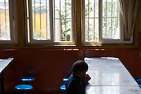 A blind Tibetan student has breakfast at the canteen of the School for the Blind in Tibet, in the capital city of Lhasa, September 2016.