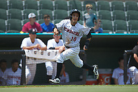 Nick Madrigal (10) of the Kannapolis Intimidators hustles towards home plate against the Hagerstown Suns at Kannapolis Intimidators Stadium on July 17, 2018 in Kannapolis, North Carolina. The Intimidators defeated the Suns 10-9. (Brian Westerholt/Four Seam Images)