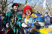 Düsseldorf, Germany. 15 February 2015. Two clowns tapping a keg. Street carnival celebrations take place on Königsallee (Kö) in Düsseldorf ahead of the traditional Shrove Monday parade (Rosenmontagszug).