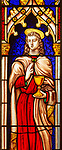 Stained glass window in church of Saint Margaret, Chilmark, Wiltshire, England, UK - Heaton, Butler and Bayne 1856 Saint John