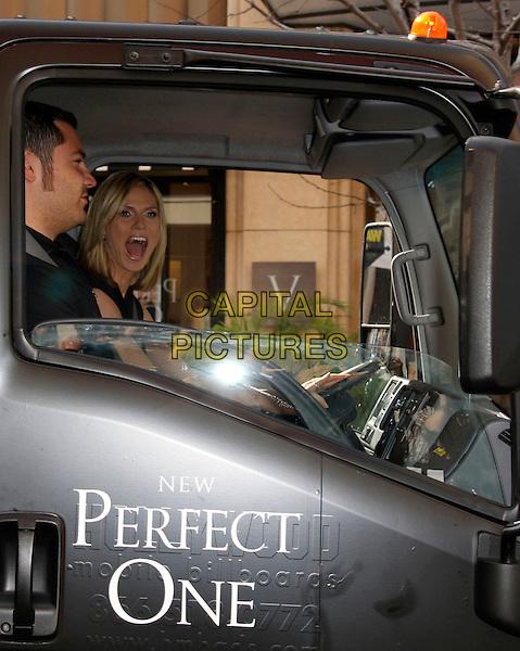 "HEIDI KLUM.Heidi Klum unveils the ""Perfect One"" bra at Victoria's Secret held at the Grove, Los Angeles, California, USA..March 3rd, 2009.car truck van sitting mouth open driving half length.CAP/ADM/KB.©Kevan Brooks/AdMedia/Capital Pictures."