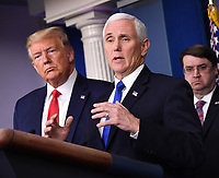 United States Vice President Mike Pence delivers remarks on the COVID-19 (Coronavirus) pandemic as US President Donald J. Trump looks on in the Brady Press Briefing Room at the White House in Washington, DC on Wednesday, March 18, 2020.  At right is US Secretary of Veterans Affairs (VA) Robert Wilkie.  <br /> Credit: Kevin Dietsch / Pool via CNP/AdMedia