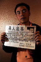 Mr. Li holds the missing person advert that advertises for his 2-year-old son whose nickname is Xiao Zhi, who went missing on September 10,2009 in Kunming. The advert offers minimum 10,000 RMB to whoever provides the useful leads of the boy's whereabouts. Kunming is one of China's hot-spots for child abductions in China.