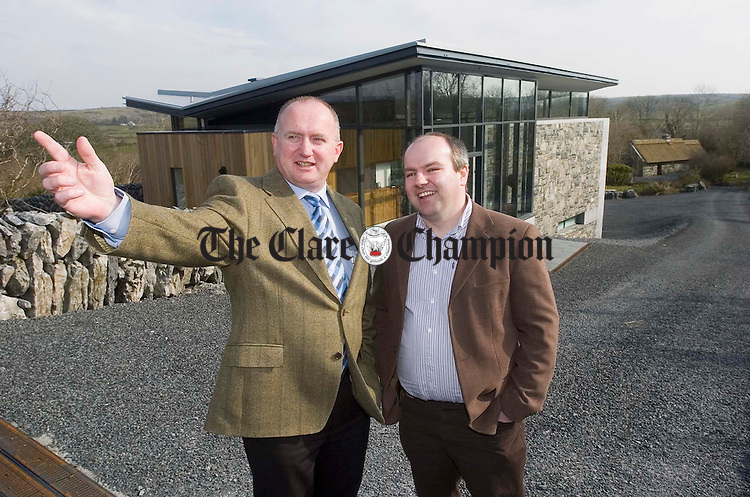 Paddy Maher, the newly appointed manager of the Michael Cusack Centre at Carron is shown around by Martin O Loghlen, chairman of the centre. Photograph by John Kelly.