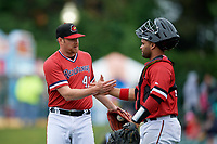 Rochester Red Wings pitcher Preston Guilmet (41) and catcher Tomas Telis (18) celebrate closing out an International League game against the Charlotte Knights on June 16, 2019 at Frontier Field in Rochester, New York.  Rochester defeated Charlotte 11-5 in the first game of a doubleheader that was a continuation of a game postponed the day prior due to inclement weather.  (Mike Janes/Four Seam Images)