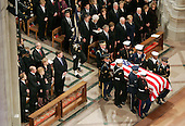 United States President George W. Bush walks past the casket of former U.S. President Gerald R. Ford during funeral services at the National Cathedral in Washington, DC on Tuesday, January 2, 2007. The Ford Family, Including Betty Ford, her sons Mike, Steven, Jack and Daughter Susan sit in the front row on the left and current US President George W. Bush, as well as former Presidents George H.W. Bush, Bill Clinton and Jimmy Carter attended the service.<br /> Credit: Shawn Thew - Pool via CNP