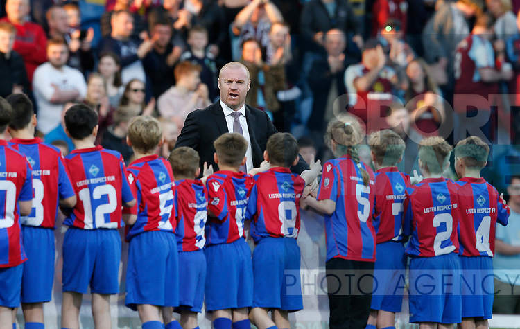 Sean Dyche manager of Burnley greets waiting mascots during the premier league match at the Turf Moor Stadium, Burnley. Picture date 19th April 2018. Picture credit should read: Simon Bellis/Sportimage