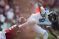NWA Democrat-Gazette/CHARLIE KAIJO Arkansas Razorbacks defensive back Kamren Curl (2) tackles Coastal Carolina Chanticleers wide receiver Chris Jones (8) during a football game on Saturday, November 4, 2017 at Razorback Stadium in Fayetteville
