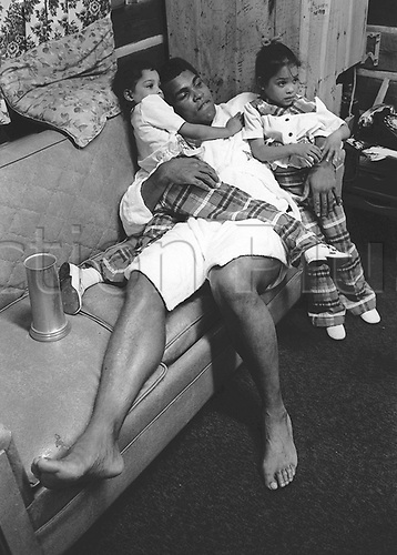 Boxer Cassius Clay and his children on the sofa (undated). Muhammad Ali died on June 3rd 2016 of a respiratory complication in a Phoenix hospital.