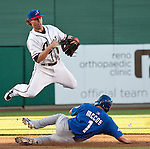 Reno Aces second baseman Jake Elmore turns a double play as Las Vegas 51s runer Mike Mccoy slides during their game on Monday night July 3, 2012 at Aces Ballpark in Reno, NV.