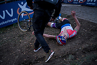 after crossing the finish line Mathieu van der Poel (NED/Beobank-Corendon) immediatly dropped to the ground, completely exhausted, trying to catch his breath again<br /> <br /> Elite Men's race<br /> Koppenbergcross / Belgium 2017